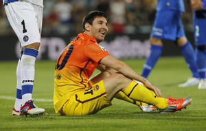 Photo -   FC Barcelona's Lionel Messi from Argentina gestures during a Spanish La Liga soccer match against Getafe at the Coliseum Alfonso Perez stadium in Getafe, near Madrid, Spain, Saturday, Sept. 15, 2012. (AP Photo/Andres Kudacki)