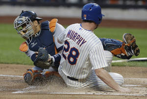 Photo - New York Mets' Daniel Murphy (28) slides against Detroit Tigers catcher Victor Martinez to score on a single by Marlon Byrd during the first inning of an interleauge baseball game Friday, Aug. 23, 2013, in New York. (AP Photo/Frank Franklin II)