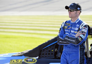 Photo - Dale Earnhardt Jr. looks on before qualifying for the NASCAR Sprint Cup Series auto race at Chicagoland Speedway in Joliet, Ill., Friday, Sept. 13, 2013. (AP Photo/Nam Y. Huh)