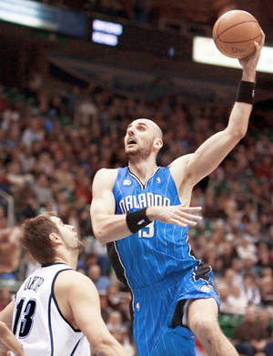 Photo - The Thunder is interested in Orlando free agent Marcin Gortat. AP photo