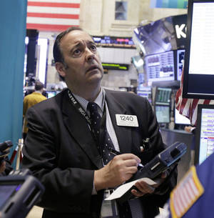 Photo - Trader Robert Maher works Thursday on the floor of the New York Stock Exchange.  AP Photo