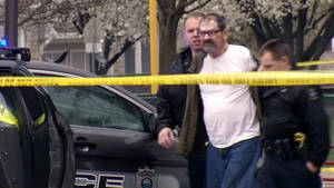 Photo - In this Sunday, April 13, 2014 image from video provided by KCTV-5, Frazier Glenn Cross, also known as Frazier Glenn Miller, is escorted by police in an elementary school parking lot in Overland Park, Kan. Cross, 73, accused of killing three people in attacks at a Jewish community center and Jewish retirement complex near Kansas City, is a known white supremacist and former Ku Klux Klan leader who was once the subject of a nationwide manhunt. (AP Photo/KCTV-5) MANDATORY CREDIT