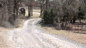 photo - A long gravel drive leads to the Blanchard home of Sarah McKinley is shown Wednesday.  Photos by Steve Sisney, The Oklahoman
