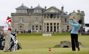 Photo - FILE - This is a  Sunday, Aug. 5, 2007 file photo of tournament winner and world number one Mexico's Lorena Ochoa as she tees off from the 18th with the St Andrews clubhouse in the background, during the Women's British Open golf tournament on the Old Course at the Royal and Ancient Golf Club in St Andrews, Scotland.  The Royal & Ancient could finally be allowing women to join one of the most influential golf clubs.  The Daily Mail newspaper on Wednesday March 26, 2014 cited a letter from the R&A to its 2,500 members recommending they change the all-male membership policy at St. Andrews.  (AP Photo/Matt Dunham, File)