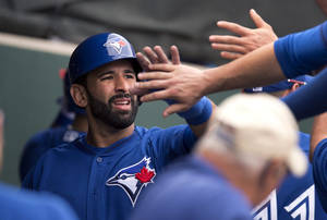 Photo - Toronto Blue Jays' Jose Bautista is congratulated by teammates after scoring in the third inning of a spring baseball exhibition game against the Philadelphia Phillies in Clearwater, Fla., on Wednesday Feb. 26, 2014. (AP Photo/The Canadian Press, Frank Gunn)