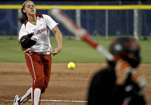 Photo - OU / OSU / COLLEGE SOFTBALL: Oklahoma's Keilani Ricketts (10) throws a pitch during the Bedlam softball game between the University of Oklahoma Sooners and the Oklahoma State University Cowgirls at ASA Hall of Fame Stadium on Wednesday, March 28 2012, in Oklahoma City, Oklahoma.  Photo by Chris Landsberger, The Oklahoman
