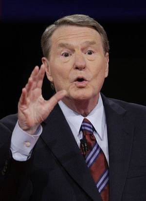 """Photo - FILE - In a Sept. 26, 2008 file photo, moderator Jim Lehrer discusses the rules of the debate with the audience prior to the start of the presidential debate, at the University of Mississippi in Oxford, Miss. Lehrer said Thursday, May 12, 2011 that he is retiring as a regular anchor of PBS' """"NewsHour"""" broadcast after 35 years. His exit will take place the week of June 6. (AP Photo/Ron Edmonds, File)"""