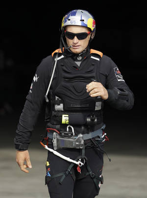Photo - Oracle Team USA skipper Jimmy Spithill walks out of the team's base and heads for his boat during training for the America's Cup, Wednesday, July 3, 2013, in San Francisco. Opening ceremonies for the sailing event are scheduled for Thursday. (AP Photo/Eric Risberg)