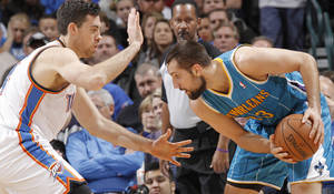 Photo - Oklahoma City Thunder's Nick Collison (4) defends on New Orleans Hornets' Ryan Anderson (33) during the NBA basketball game between the Oklahoma CIty Thunder and the New Orleans Hornets at the Chesapeake Energy Arena on Wednesday, Dec. 12, 2012, in Oklahoma City, Okla.   Photo by Chris Landsberger, The Oklahoman ORG XMIT: KOD