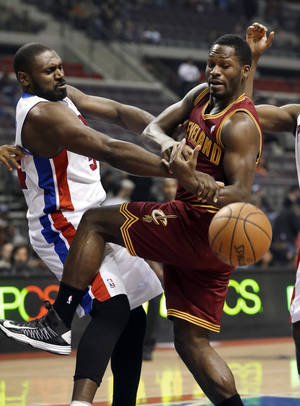 Photo - Detroit Pistons forward Jason Maxiell (54) and Cleveland Cavaliers guard Jeremy Pargo (8) vie for the ball in the first half of an NBA basketball game in Auburn Hills, Monday, Dec. 3, 2012. (AP Photo/Paul Sancya)