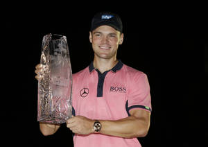 Photo - Martin Kaymer of Germany, holds The Players championship trophy at TPC Sawgrass, Sunday, May 11, 2014 in Ponte Vedra Beach, Fla. (AP Photo/John Raoux)