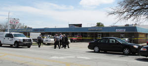 Photo - Oklahoma City police investigate a homicide Thursday afternoon at 5916 NW 16. A person was found shot in a shopping center parking lot. This is Oklahoma City's 16th homicide in 2013. Photo by LeighAnne Manwarren, The Oklahoman