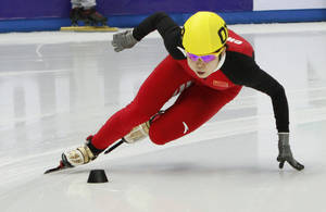 Photo - FILE- China's Wang Meng skates during women's 500-meter race at the World Cup short track speedskating championship in the Iceberg skating arena in the Black Sea resort of Sochi, Russia, in this file photo dated Saturday, Feb. 2, 2013.  Wang Meng, China's most decorated Winter Olympian, broke her ankle in training and will likely miss the Sochi Games, after she collided with a teammate on a turn on Thursday. Ang Meng underwent surgery within hours of the incident, said Liu Hao, the China team's deputy short track manager. (AP Photo/Igor Yakunin, FILE)