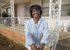 Photo - Eunice Russell is happy with the work being done at her home at 2521 NE 14th St. in Oklahoma City during Rebuilding Together. Photo By Paul Hellstern, The Oklahoman