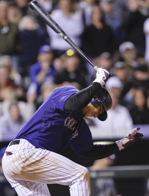 photo -   Colorado Rockies left fielder Carlos Gonzalez (5) slams his bat down into the ground after striking out to end the game during the ninth inning of a baseball game Tuesday, May 1, 2012 in Denver. The Los Angeles Dodgers won 7-6. (AP Photo/Barry Gutierrez)