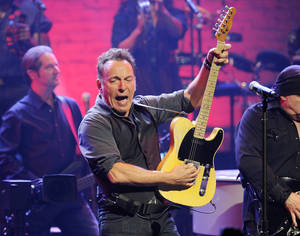 Photo -   FILE - This March 9, 2012 file photo shows Bruce Springsteen and the E Street Band performing at the Apollo Theater in New York. MusiCares announced Thursday, June 28, that Springsteen will be honored as the 2013 MusiCares Person of the Year in recognition of his extraordinary creative accomplishments as well as his significant charitable work. The 2013 MusiCares Person of the Year gala will be held on Feb. 8, 2013. (AP Photo/Evan Agostini, file)