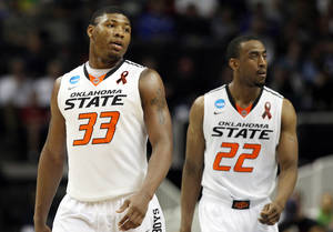 Photo - OSU's Marcus Smart and Markel Brown during the last seconds of the game against Oregon in the second round of the NCAA Basketball tournament in San Jose, CA, Mar. 21, 2013. STEPHEN PINGRY/Tulsa World