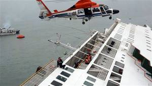 Photo - In this image taken from video released by News Y via Yonhap, passengers from a ferry sinking off South Korea's southern coast, are rescued by a South Korean Coast Guard helicopter in the water off the southern coast near Jindo, south of Seoul, Wednesday, April 16, 2014. Nearly 300 people were still missing Wednesday several hours after the ferry carrying 477, most of them high school students, sank in cold waters off South Korea's southern coast. (AP Photo/Yonhap) KOREA OUT