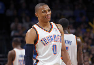 photo - Oklahoma City's Russell Westbrook (0) reacts to a play during the NBA basketball game between the Oklahoma City Thunder and Utah Jazz, Wednesday, March 23, 2011, at the Oklahoma City Arena. Photo by Sarah Phipps, The Oklahoman