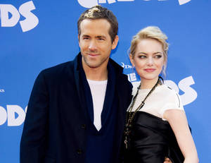 "Photo - FILE - This March 10, 2013 file photo shows actors Ryan Reynolds, left, and Emma Stone at ""The Croods"" premiere in New York. Reynolds voices the character Guy and Stone voices the character Eep in the Dreamworks Animation film. (Photo by Charles Sykes/Invision/AP)"