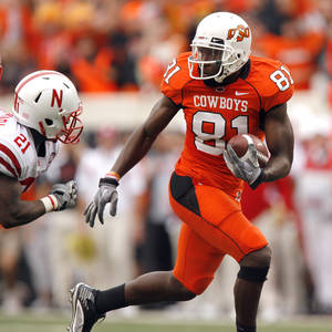 Photo - OSU's Justin Blackmon looks back at Nebraksa's Prince Amukamara after a catch during the college football game between the Oklahoma State Cowboys (OSU) and the Nebraska Huskers (NU) at Boone Pickens Stadium in Stillwater, Okla., Saturday, Oct. 23, 2010. Photo by Sarah Phipps, The Oklahoman
