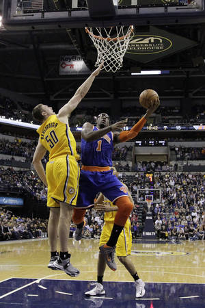 Photo - New York Knicks' Amare Stoudemire (1) shoots against Indiana Pacers' Tyler Hansbrough (50) during the first half of an NBA basketball game, Thursday, Jan. 10, 2013, in Indianapolis. (AP Photo/Darron Cummings)
