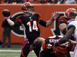 Photo -   Cincinnati Bengals quarterback Andy Dalton (14) passes against the Miami Dolphins in the second half of an NFL football game on Sunday, Oct. 7, 2012, in Cincinnati. (AP Photo/Tom Uhlman)