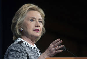 "Photo - FILE - This May 14, 2014, file photo shows former Secretary of State Hillary Rodham Clinton speaking in Washington. Clinton says she feels emboldened to run for president because of Republican criticism of her handling of the deadly 2012 terrorist attacks in Benghazi, Libya. Clinton says in an interview with ABC News airing June 9 that she remains undecided about another campaign in 2016. But she says the GOP-led Benghazi inquiry is ""more of a reason to run"" because she considers the multiple investigations into the attacks ""minor league ball"" for a country of the United States' stature. (AP Photo/Cliff Owen, File)"