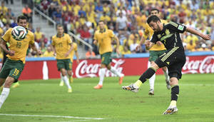 Photo - Spain's David Villa fires wide with a shot during the group B World Cup soccer match between Australia and Spain at the Arena da Baixada in Curitiba, Brazil, Monday, June 23, 2014. (AP Photo/Martin Meissner)
