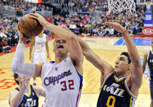 Photo - Los Angeles Clippers forward Blake Griffin, left, goes up for a shot as Utah Jazz center Enes Kanter, of Turkey, defends during the first half of an NBA basketball game, Sunday, Dec. 30, 2012, in Los Angeles. (AP Photo/Mark J. Terrill)