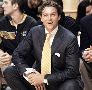 Photo - FILE - In this Nov. 8, 2005, file photo, Missouri coach Quin Snyder shares a laugh with the referee during the first half of their  87-61 victory over Missouri Southern in an exhibition college basketball game in Columbia, Mo. Snyder was the hot young coaching prospect at Missouri. As suddenly as he led the Tigers to success, he fell as quick. Out of sight for years in the NBDL, Snyder has resurfaced as an assistant coach with the Philadelphia 76ers. (AP Photo/L.G. Patterson, File) ORG XMIT: NY159