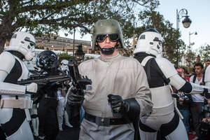 "Photo - Star Wars fans wearing stormtrooper costumes parade along Tunis' stately, tree-lined Bourguiba Avenue, in Tunisia, Wednesday, April 30, 2014. The empire was not striking back against the poster child for Arab democracy — just an innovative campaign to encourage tourists to return to this sunny desert-and-beach nation in North Africa. ""We came here to Tunis to help save the Star Wars sites in Matmata and Tozeur and convince people to return to Tunisia,"" said Ingo Kaiser, head of a Star Wars fan club in Europe, referring to the movie sets that are slowly being covered up by sand in the Tunisian desert. (AP Photo/Aimen Zine)"
