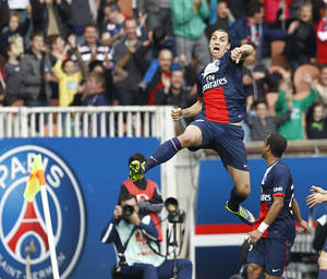 Photo - Paris Saint Germain's Zlatan Ibrahimovic jumps in the air after scoring the second goal against Bastia, during the French League One soccer match between Paris Saint Germain and Bastia, at the Parc des Princes stadium, in Paris, Saturday, Oct. 19, 2013.(AP Photo/Remy de la Mauviniere)