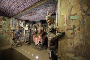"Photo - A full scale replica cave from the 8th century that contains the Bodhisattva of the Mogao Caves is presented in ""Dunhuang: Buddhist Art at the Gateway of the Silk Road,"" at the China Institute, in New York,  Tuesday, April 24, 2013. (AP Photo/Richard Drew)"