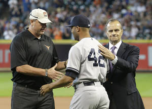 Photo - New York Yankees relief pitcher Mariano Rivera (42) is greeted by former Yankees pitcher Roger Clemens, left, and former manager Joe Torre before the ceremony honoring Rivera before the baseball game against the Houston Astros Sunday, Sept. 29, 2013, in Houston. Rivera is retiring after 18 years in baseball. (AP Photo/Richard Carson)