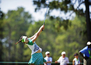 Photo - Amateur Lucy Li, 11, hits from the fairway on the 15th hole during a practice round at the U.S. Women's Open golf tournament at Pinehurst No. 2, Tuesday, June 17, 2014, in Pinehurst, N.C. The sixth-grader from California is the youngest qualifier in the history of the U.S. Women's Open.  (AP Photo/The Fayetteville Observer, Abbi O'Leary) MANDATORY CREDIT, MAGS OUT, NO SALES