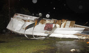 Photo - Campers at Santa Maria RV Park on Martin Bluff Road in Gautier, Miss., were flipped from possible straight line winds Monday, April 14, 2014, as storms rolled over the Coast. As many as 30 campers were damaged from the storm. (AP Photo/Sun Herald, Tim Isbell)