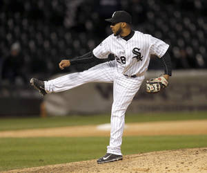 Photo - Chicago White Sox second baseman Leury Garcia, pitches in relief during the 14th inning of a baseball game against the Boston Red Sox Thursday, April 17, 2014, in Chicago. The Red Sox won 6-4. (AP Photo/Charles Rex Arbogast)