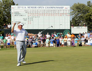 Photo - Colin Montgomerie reacts after sinking his final putt on No. 18 in a third playoff hole to win the U.S. Senior Open during the final round of the golf tournament at Oak Tree National in Edmond, Okla., Sunday, July 13, 2014. Photo by Nate Billings, The Oklahoman