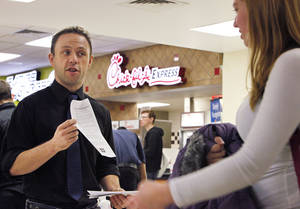 Photo - University of Central Oklahoma student Kyle Brower hands out information about Chick-fil-A corporate policies Tuesday at UCO's Nigh University Center. Photo By David McDaniel, The Oklahoman <strong>David McDaniel</strong>