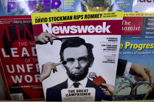 photo -   A copy of Newsweek is seen at Joe's Smoke, Thursday, Oct. 18, 2012, in Portland, Maine. Newsweek announced Thursday, Oct. 18, 2012 that it will end its print publication after 80 years and shift to an all-digital format in early 2013. Its last U.S. print edition will be its Dec. 31 issue. The paper version of Newsweek is the latest casualty of a changing world where readers get more of their information from websites, tablets and smartphones. (AP Photo/Robert F. Bukaty)