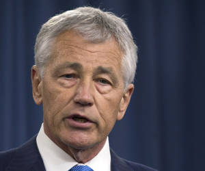 Photo - FILE - In this March 1, 2013 file photo, Defense Secretary Chuck Hagel speaks during a news conference at the Pentagon. Hagel plans to announce Friday that the Obama administration has decided to add 14 interceptors on the West Coast to the U.S.-based missile defense system. (AP Photo/Carolyn Kaster, File)