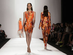 Photo -   The J. Mendel Spring 2013 collection is modeled during Fashion Week in New York, Wednesday, Sept. 12, 2012. (AP Photo/Richard Drew)