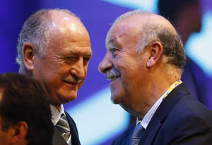 Photo - Brazil head coach Luiz Felipe Scolari, left, talks with Spain head coach Vicente Del Bosque after the draw ceremony for the 2014 soccer World Cup in Costa do Sauipe near Salvador, Brazil, Friday, Dec. 6, 2013. (AP Photo/Victor R. Caivano)