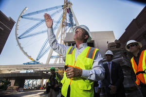 Photo - FILE - In a Tuesday, July 30, 2013 file photo, the world's tallest observation wheel, know as the High Roller is seen behind David Codiga, executive project director for The Linq, at The Linq construction site on Las Vegas Boulevard. The outer wheel of the 55-story High Roller ride is scheduled to be hoisted into place Monday, Sept. 9, 2013. (AP Photo/Las Vegas Review-Journal, Jeff Scheid, File) LOCAL TV OUT; LOCAL INTERNET OUT; NVLVS OUT (Las Vegas Sun out)