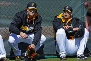 Photo - Pittsburgh Pirates pitchers Gerrit Cole, left, and Charlie Morton take a break after throwing a bullpen session on the baseball team's first day of spring training for pitchers and catchers, in Bradenton, Fla., Thursday, Feb. 13, 2014. (AP Photo/Gene J. Puskar)