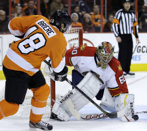 photo - Florida Panthers&#039; Jose Theodore, right, blocks a shot by Philadelphia Flyers&#039; Danny Briere during the second period of an NHL hockey game, Thursday, Feb. 7, 2013, in Philadelphia. (AP Photo/Matt Slocum)