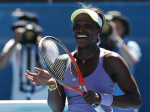 photo - Sloane Stephens of the US celebrates after defeating compatriot Serena Williams in their quarterfinal match at the Australian Open tennis championship in Melbourne, Australia, Wednesday, Jan. 23, 2013.  (AP Photo/Aaron Favila)