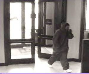 Photo - A robber enters MidFirst Bank, 810 SW 44, about 9:05 a.m. Friday. He showed a revolver and left with an undisclosed amount of cash. PHOTO PROVIDED