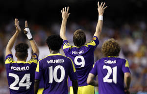 Photo - Swansea City's Michu from Spain, second right, celebrates after scoring against Valencia during their Europa League Group A soccer match at the Mestalla stadium in Valencia, Spain, Thursday, Sept. 19, 2013. (AP Photo/Alberto Saiz)